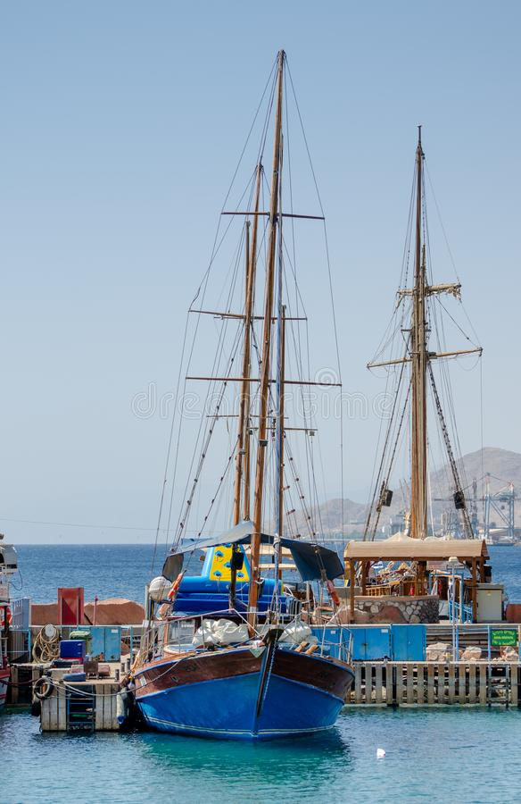 Touristic wooden sailing boats at the marina of Eilat, Red Sea. EILAT, ISRAEL - SEPTEMBER 24, 2012: Touristic wooden sailing boats at the marina of Eilat, Red royalty free stock photo