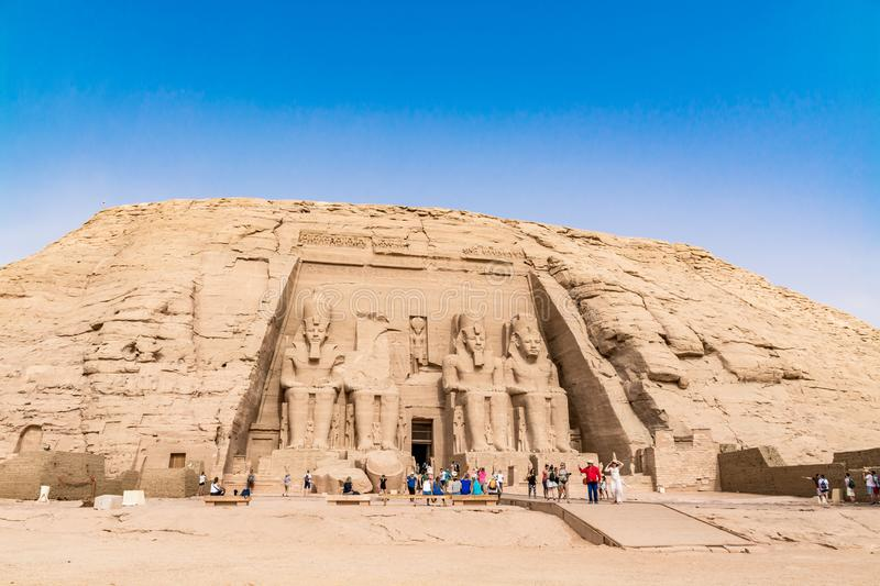 Tourists admiring the great Abu Simbel temple, Egypt royalty free stock images