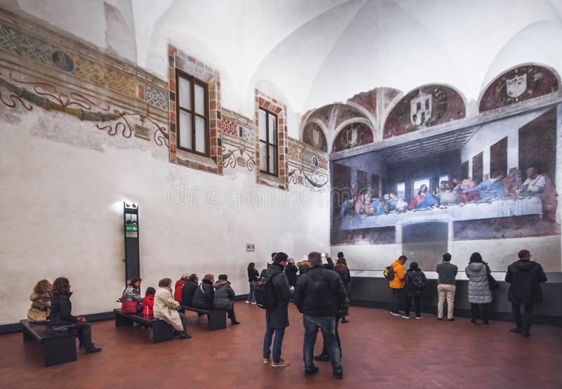 Tourists admiring the Last Supper masterpiece by Leonardo da Vinci. The Last Supper by Leonardo da Vinci in the convent of Santa Maria delle Grazie. Milan, Italy stock image