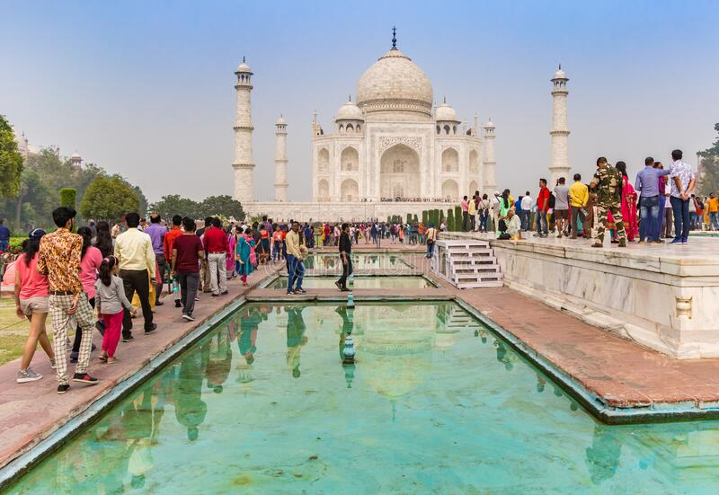 Tourists admiring the Taj Mahal from the viewing platform in Agra royalty free stock photo
