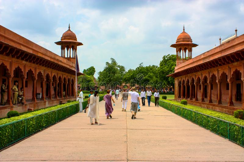 Agra, India - August 19, 2009: tourists along the boulevard through the Taj Mahal Eastern Gate in Agra, India royalty free stock image