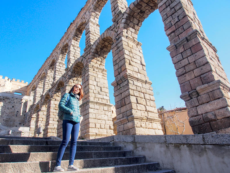 Tourists with ancient aqueduct, Segovia, Spain stock photography