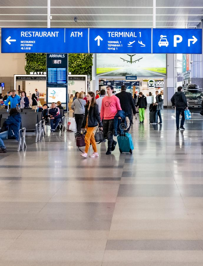 Tourists arrive at Prague international Airport ready to leave the airport and start their holidays stock photo