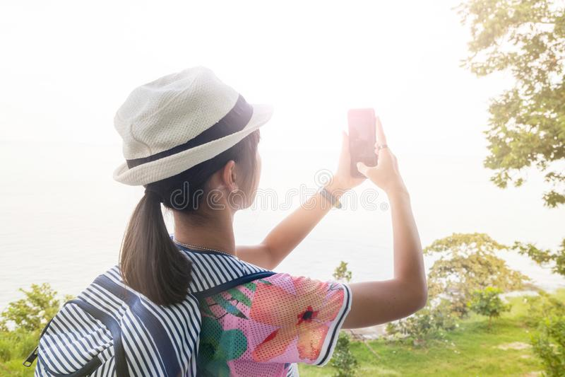 Tourists, Asian girls, selfies and fun taking pictures with mobile phones in tourist attractions. In Thailand stock photo