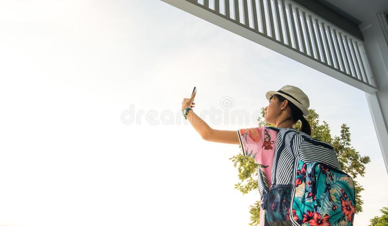 Tourists, Asian girls, selfies and fun taking pictures with mobile phones in tourist attractions. In Thailand stock photography