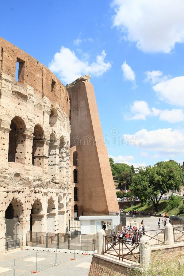 Tourists by back entry to Colosseum royalty free stock images