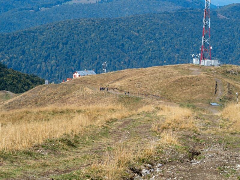 Tourists on Baiului mountains, Romania. Azuga/Romania - September 28 2019: Tourists on Baiului mountains. The Baiu Mountains are located in central Romania, a royalty free stock images