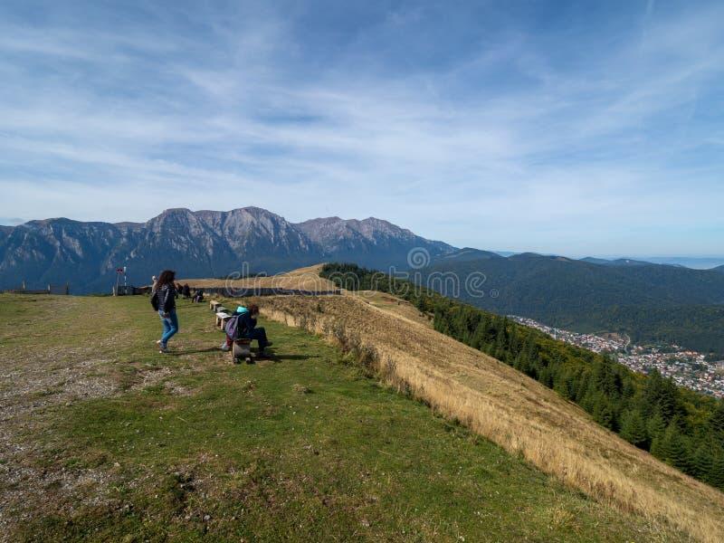 Tourists on Baiului mountains, Romania. Azuga/Romania - September 28 2019: Tourists on Baiului mountains. The Baiu Mountains are located in central Romania, a royalty free stock image