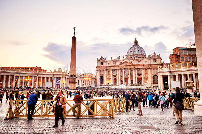 Tourists and the Basilica of St. Peter in the Vatican at dusk. VATICAN CITY, VATICAN - OCTOBER 29: Tourists and the Basilica of St. Peter in the Vatican at dusk stock image
