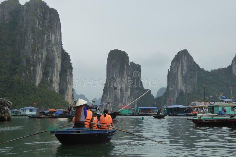 Tourists boats near the islands of ha long bay Vietnam royalty free stock photos