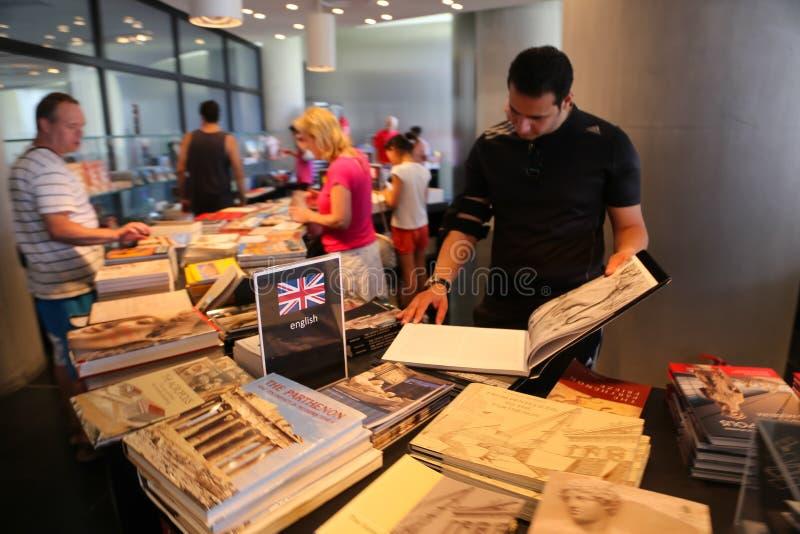 Tourists at bookshop. Tourists walling Bookshop in Hydra island, Greece islands royalty free stock photos