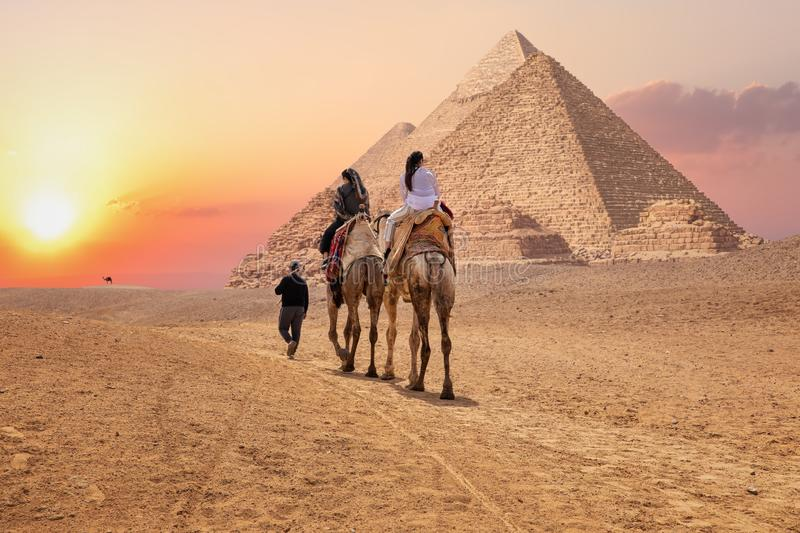 Tourists on camels near the Great Pyramids of Giza, Egypt royalty free stock images