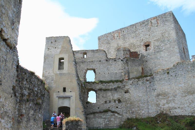 Tourists among castle walls stock photography