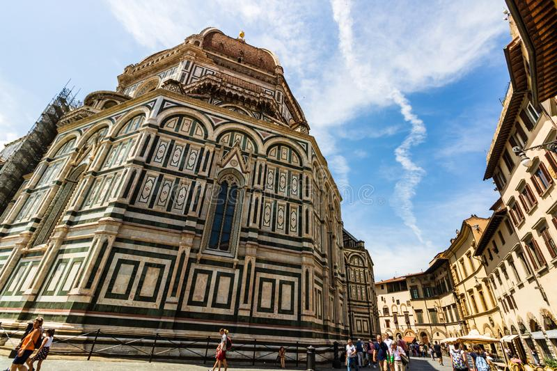 Tourists at the Cathedral of Santa Maria del Fiore and the Baptistery of St. John Battistero di San Giovanni. Florence, Italy - 2019. Tourists at the Cathedral royalty free stock images