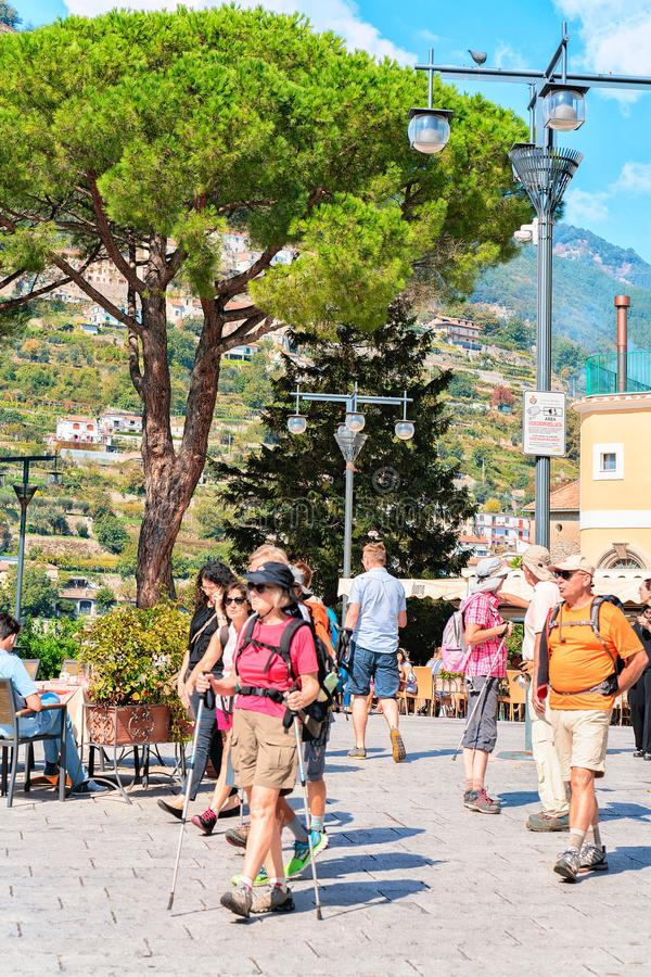 Tourists on central square at Ravello village. Ravello, Italy - October 2, 2017: People at street restaurant on central square at Ravello village, Tyrrhenian sea stock photos