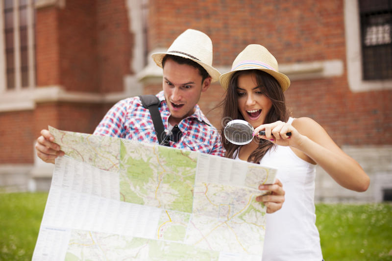 Tourists Checking Something On Map Stock Images