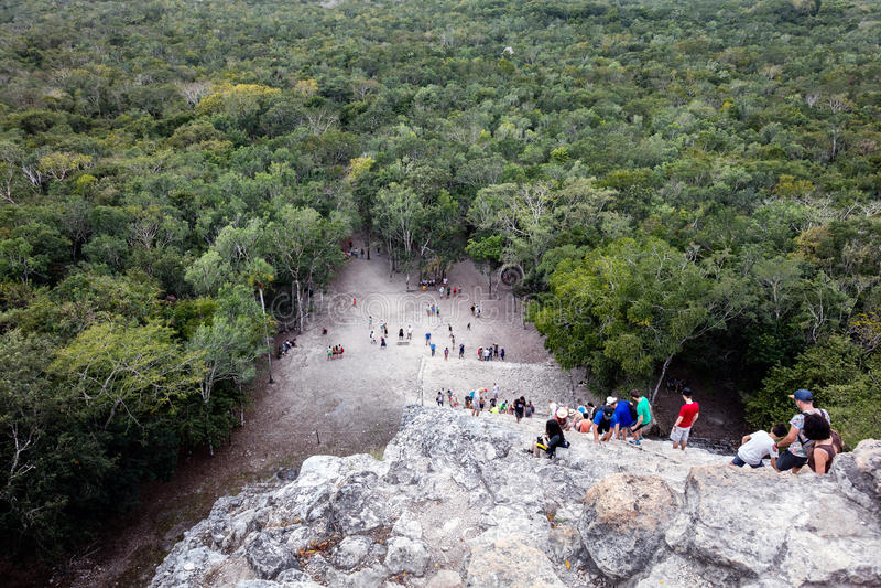 Tourists climbing the Coba Pyramid royalty free stock images