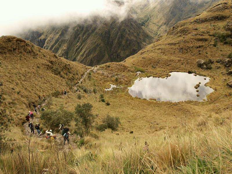 Tourists climbing the Inca trail royalty free stock image