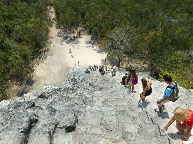 Tourists climbing a Mayan pyramid in Mexico royalty free stock photos