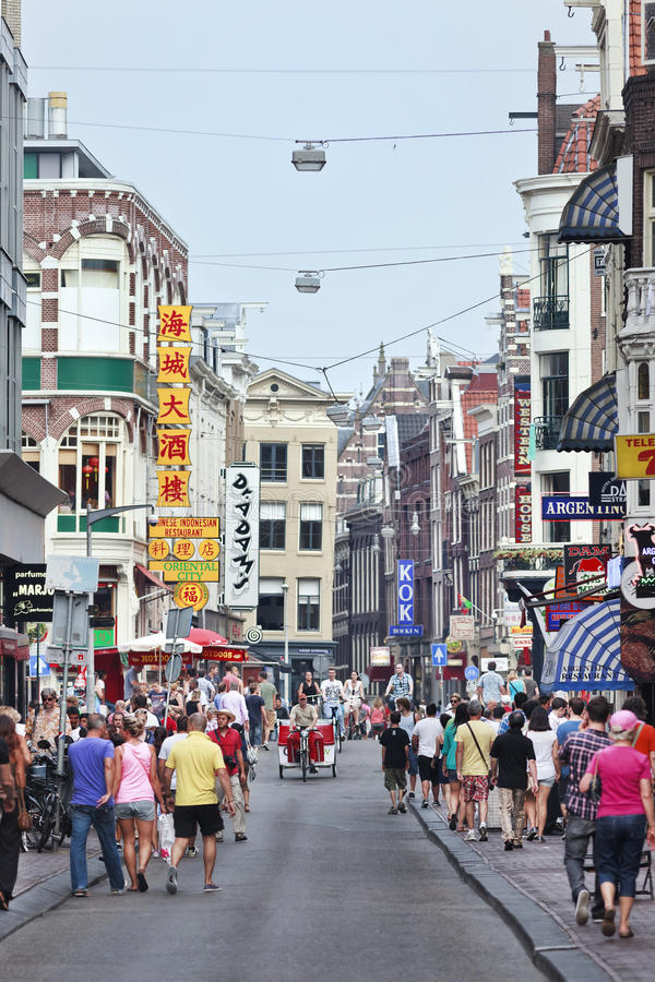 Tourists in The Damstraat, Amsterdam, Holland stock images