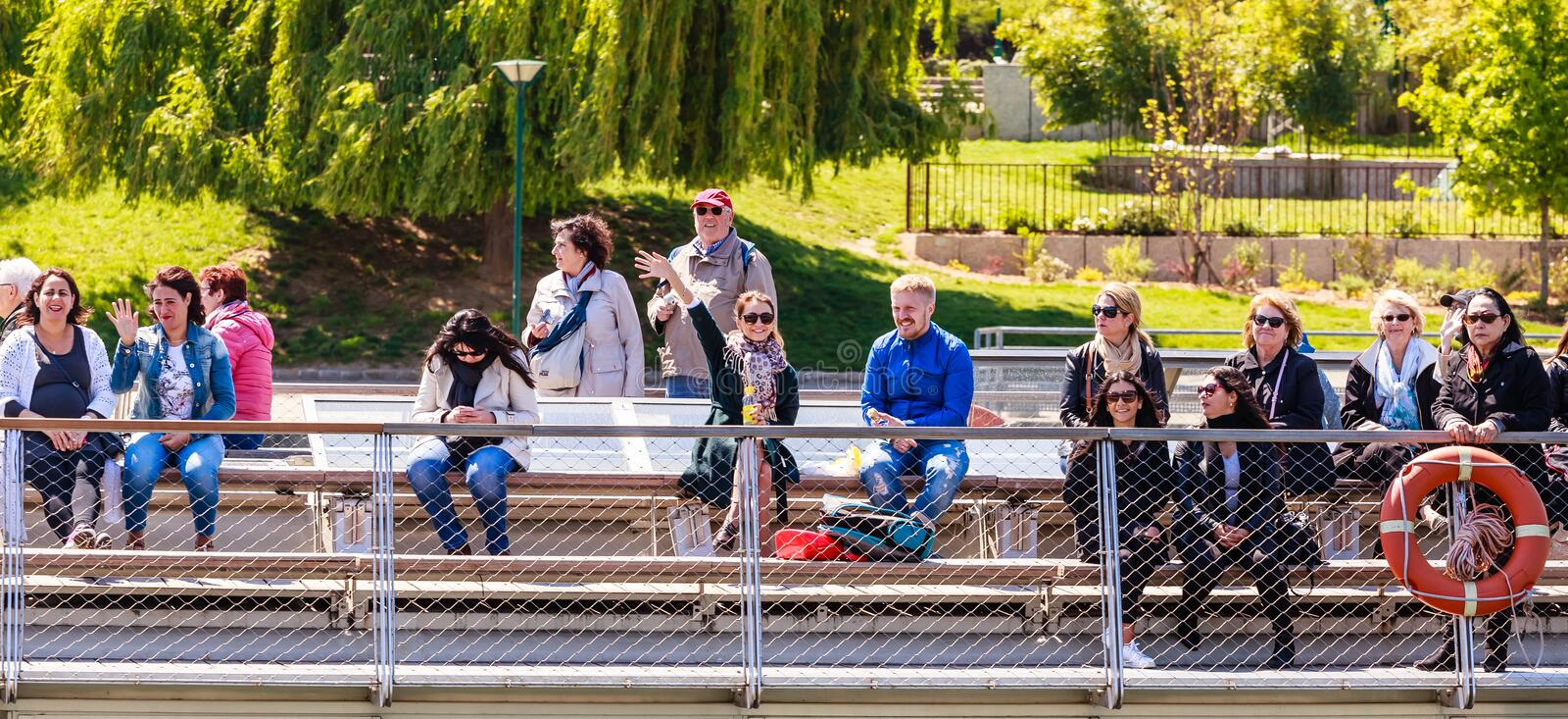 Tourists on decka tourist boat made salutation royalty free stock images
