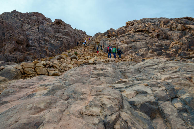 Tourists descend from Mount Moses, Egypt stock photography
