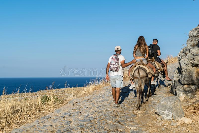 Tourists on Donkeys in Lindos royalty free stock images