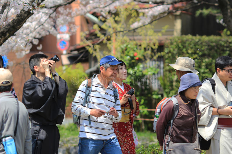 Tourists enjoy cherry blossom at Path of Philosophy in Kyoto. It is a pedestrian path that follows a cherry-tree-lined canal in Kyoto stock images