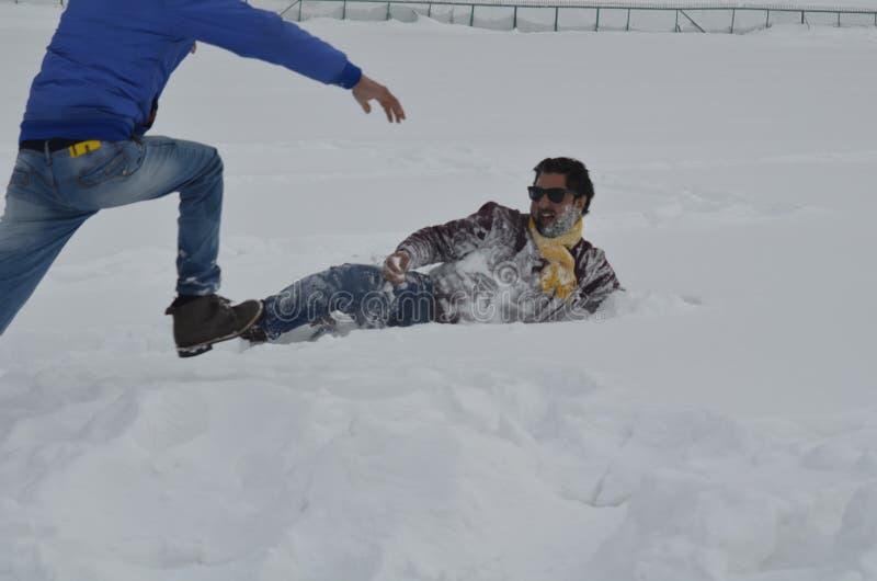 Tourists Enjoy At Gulmarg Kashmir Baramulla Country india. Tourists Enjoy with snow at Gulmarg Kashmir Baramulla Country india royalty free stock images