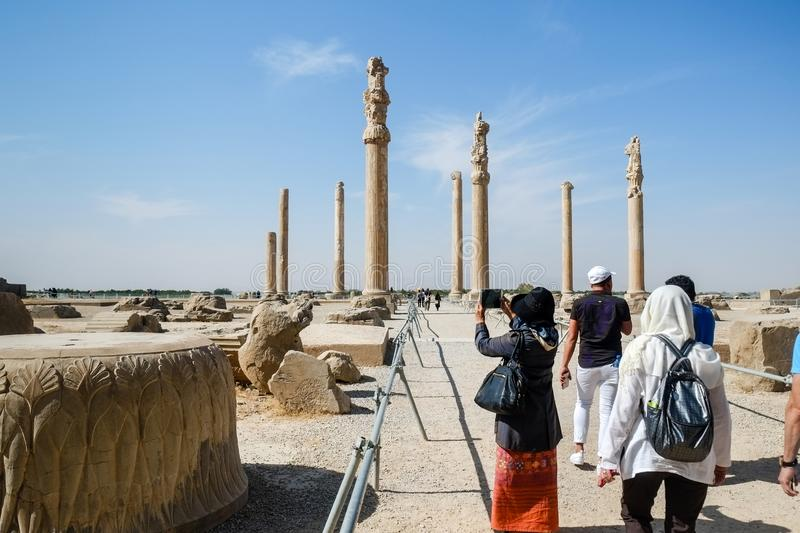 Tourists enjoy sightseeing at the Persepolis. stock photos