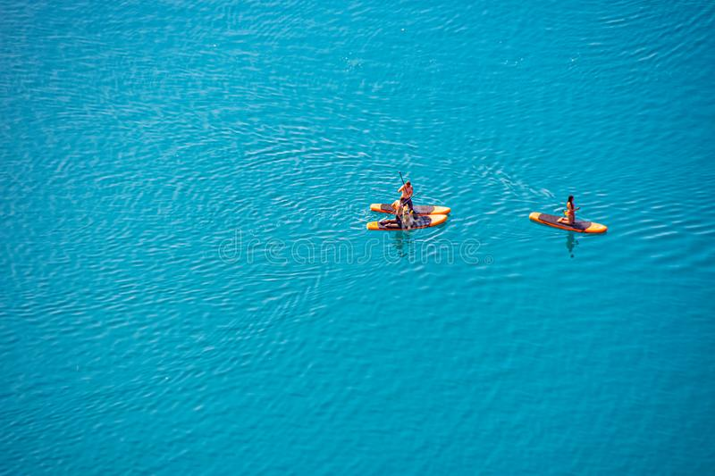 Tourists enjoy in the stand up paddle on the water. On the lake Bled stock photos