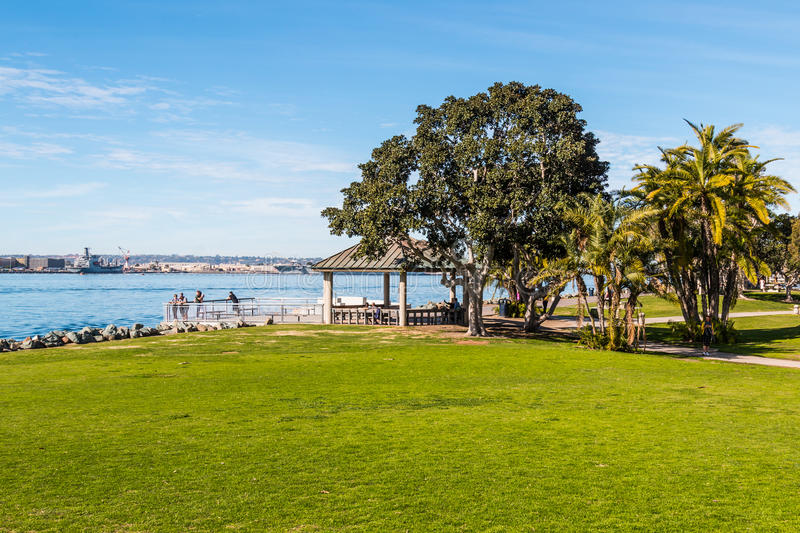 Tourists Enjoy View of San Diego Bay from Overlook. SAN DIEGO, CALIFORNIA - JANUARY 8, 2017: Tourists enjoy the view from an overlook of the bay at Embarcadero royalty free stock photo