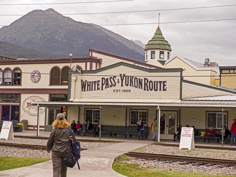 Scenic White Pass & Yukon Route: Skagway Terminus. Tourists enjoyed their time aboard the White Pass & Yukon Route railroad which was built in 1898 concurrent royalty free stock image