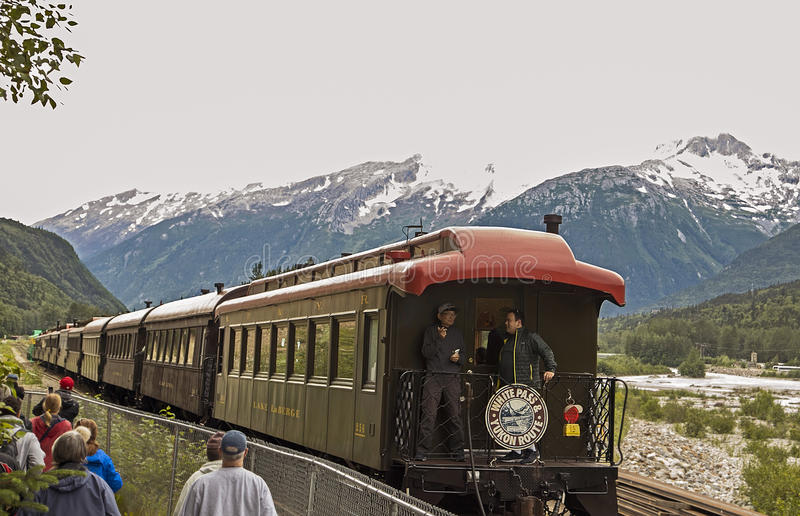 Scenic White Pass & Yukon Route. Tourists enjoyed their time aboard the White Pass & Yukon Route railroad which was built in 1898 concurrent with the Klondike royalty free stock images