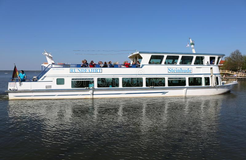 Tourists enjoying Boat Tour at Steinhude Meer royalty free stock photo