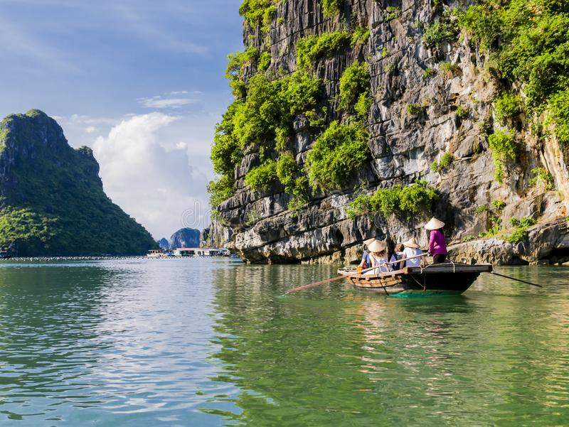 Tourists enjoying a boat trip in halong bay, Vietnam. Tourists enjoying a boat trip through the limestone mountains of halong bay, Vietnam stock photos