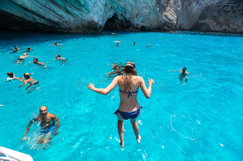 Tourists Enjoying The Clear Water Of Zakynthos Island In Greece