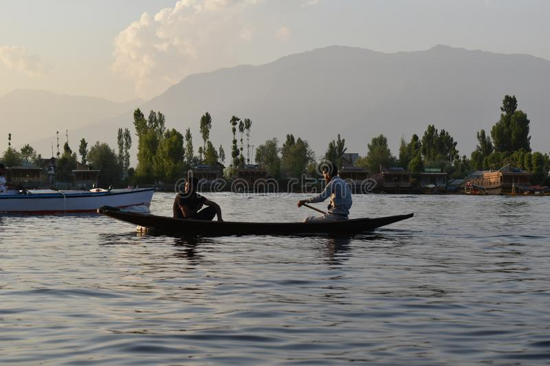 Tourists enjoying in the boats with trees background in Dal lake, Srinagar, Jammu and Kashmir, India royalty free stock image