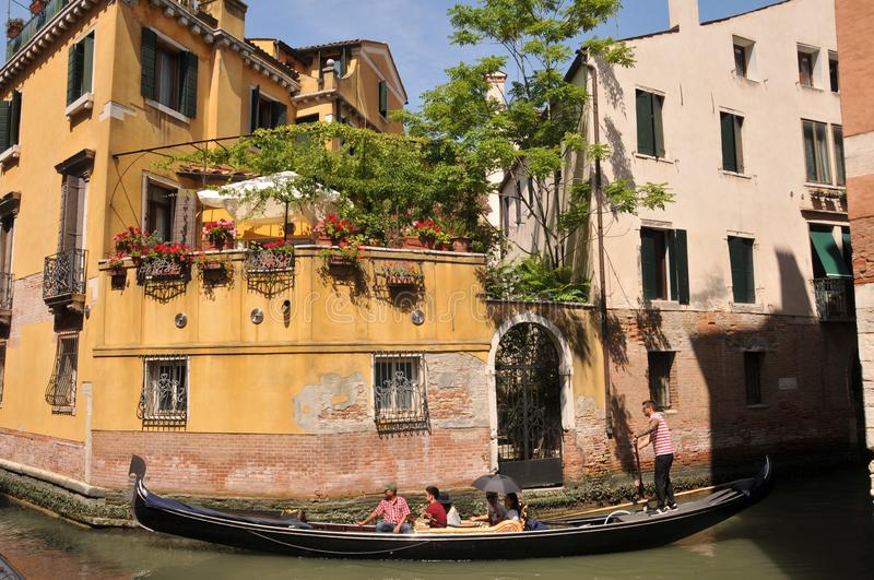 Tourists enjoying a Gondola trip on the Venice canal system royalty free stock images