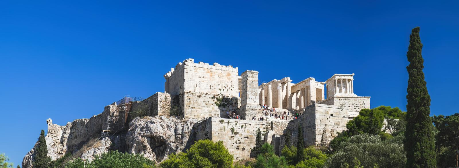 Tourists enjoying Parthenon temple, Athens, Greece. Tourists enjoying Parthenon temple on the Acropolis of Athens, view from the sightseeing point of Areopagus stock photography
