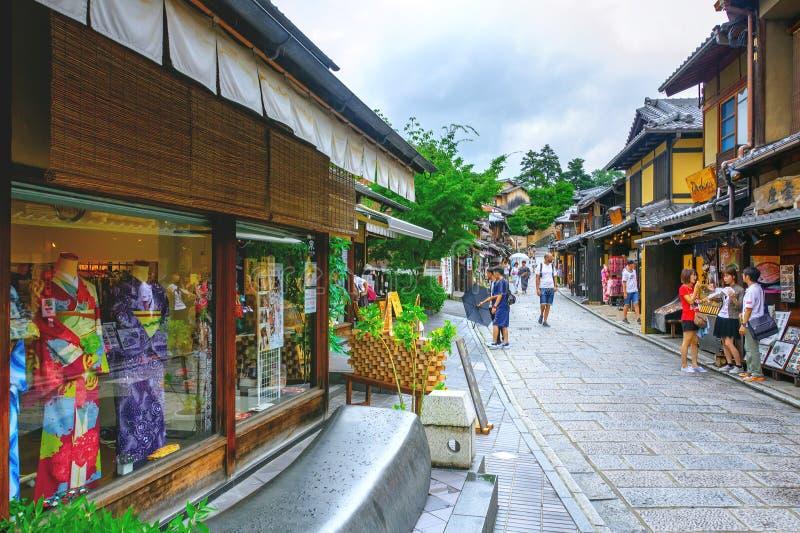 Tourists are enjoying on the Sannen-Zaka, Kyoto, Japan. Kyoto, Japan - July 23, 2015: Tourists are enjoying on the Sannen-Zaka, Kyoto famous preserved street on stock photos