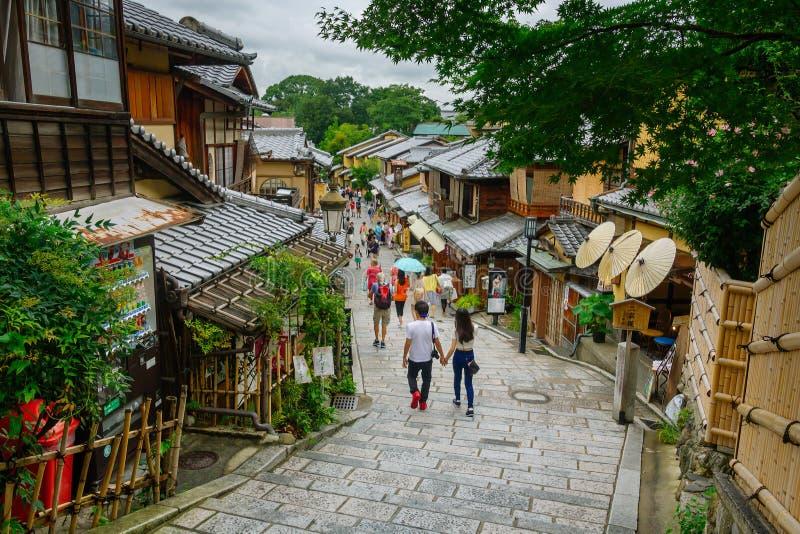 Tourists are enjoying on Sannen-Zaka street, Kyoto, Japan. Kyoto, Japan - July 23, 2015: Tourists are enjoying on the Sannen-Zaka, Kyoto famous preserved street royalty free stock image