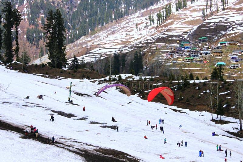 Tourists enjoying at Solang Valley. Tourists enjoying paragliding at Solang Valley, Manali. Himachal Pradesh. India royalty free stock photo