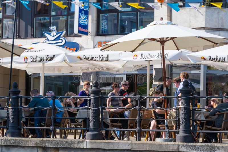 Tourists enjoying a sunny spring day at a riverside restaurant royalty free stock photos