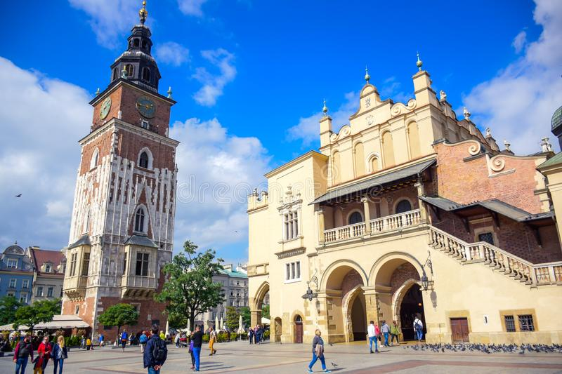 Tourists at Krakow Cloth Hall and and Town Hall Tower located in center of town square in the Krakow, Poland stock photography