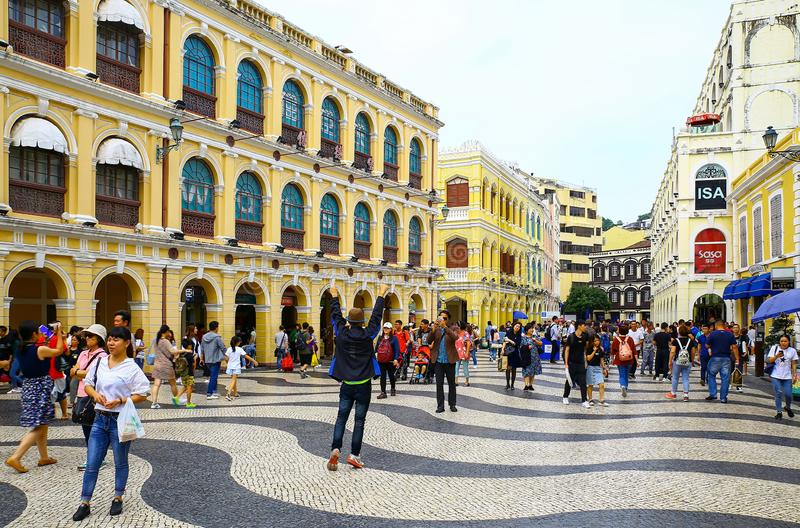 Largo do senado senado square at macau with tourists. Tourists enjoying themselves taking selfies and sightseeing at senado square located at central district of stock photography