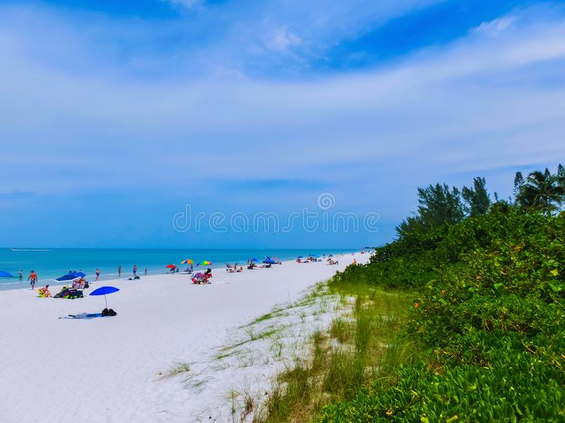 Tourists enjoying the Vanderbilt beach in Naples, Florida. Naples is located on the Gulf Coast in southern Florida stock photos
