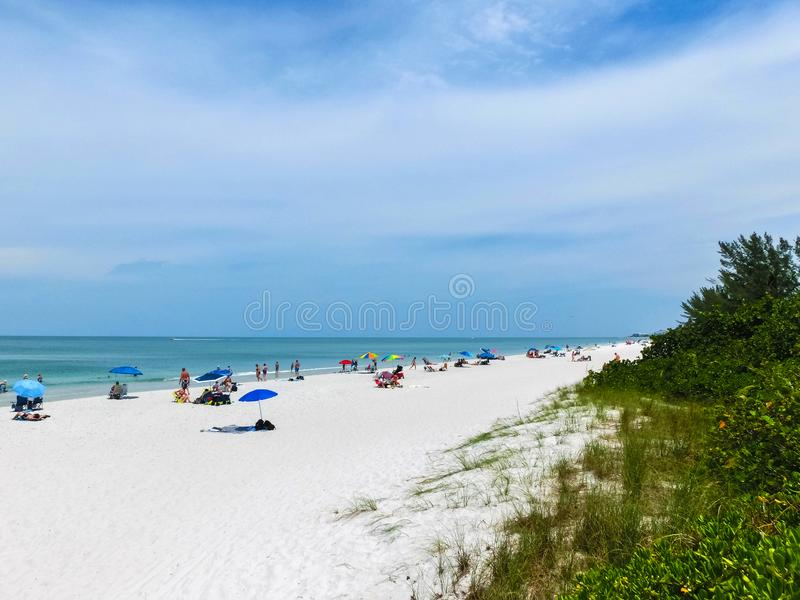 Tourists enjoying the Vanderbilt beach in Naples, Florida. Naples is located on the Gulf Coast in southern Florida royalty free stock images
