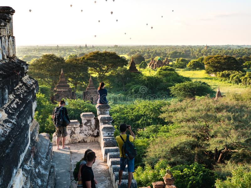 Tourists enjoying the view of Bagan from the top of Shwesandaw P stock photography