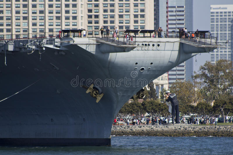 SAN DIEGO, CA - USS Midway and Victory Kiss statue royalty free stock photo